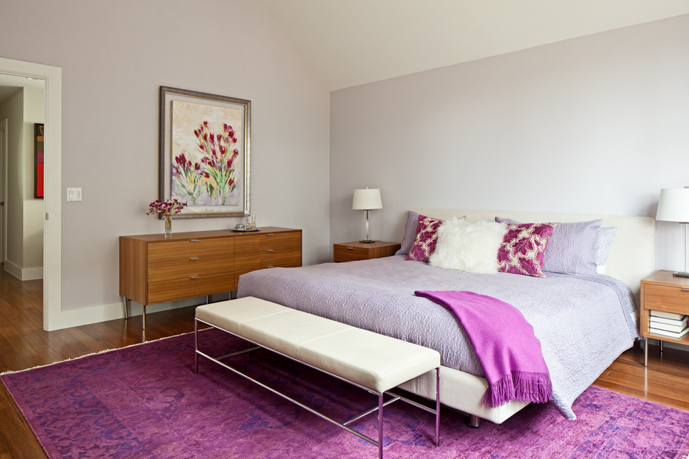 Example of a trendy bedroom design in Austin with gray walls