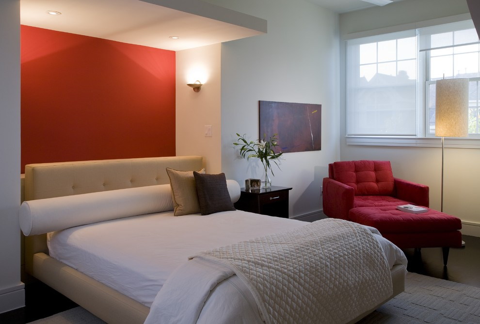 Minimalist bedroom photo in DC Metro with red walls
