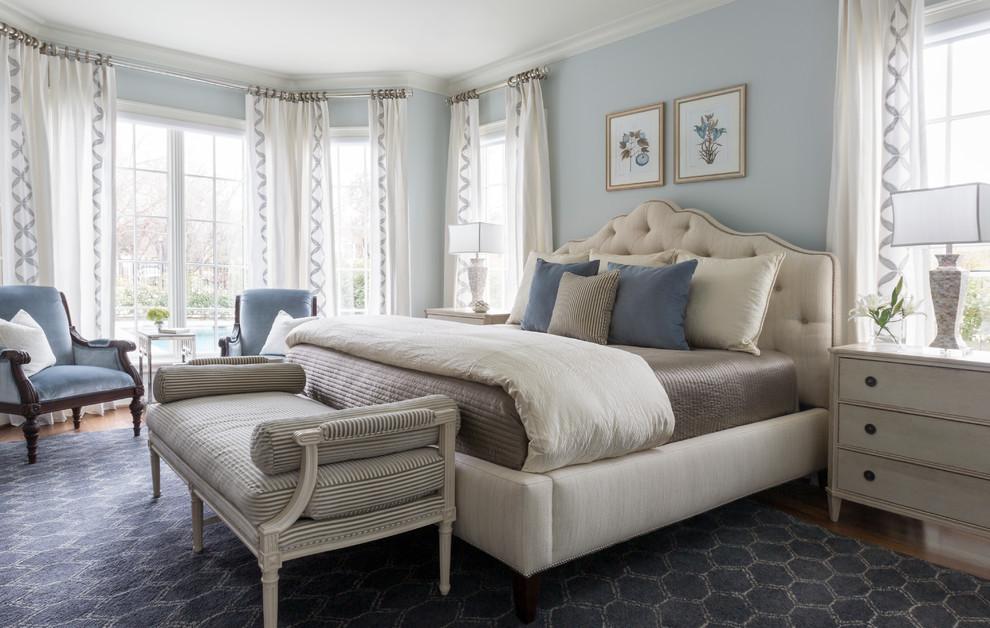 Elegant master medium tone wood floor and brown floor bedroom photo in Dallas with blue walls
