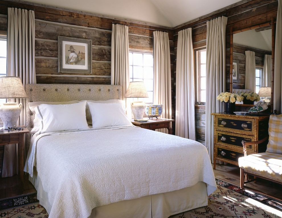 Example of a mountain style bedroom design in Other with brown walls