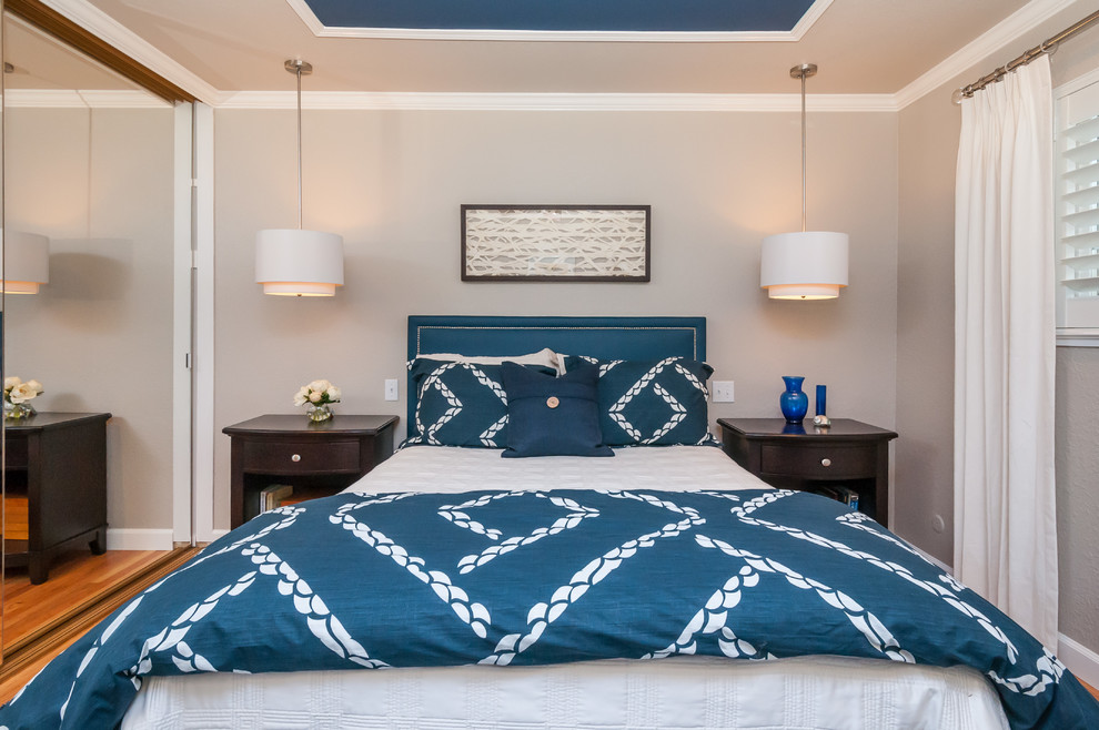 Mid-sized transitional master medium tone wood floor bedroom photo in San Francisco with beige walls and no fireplace