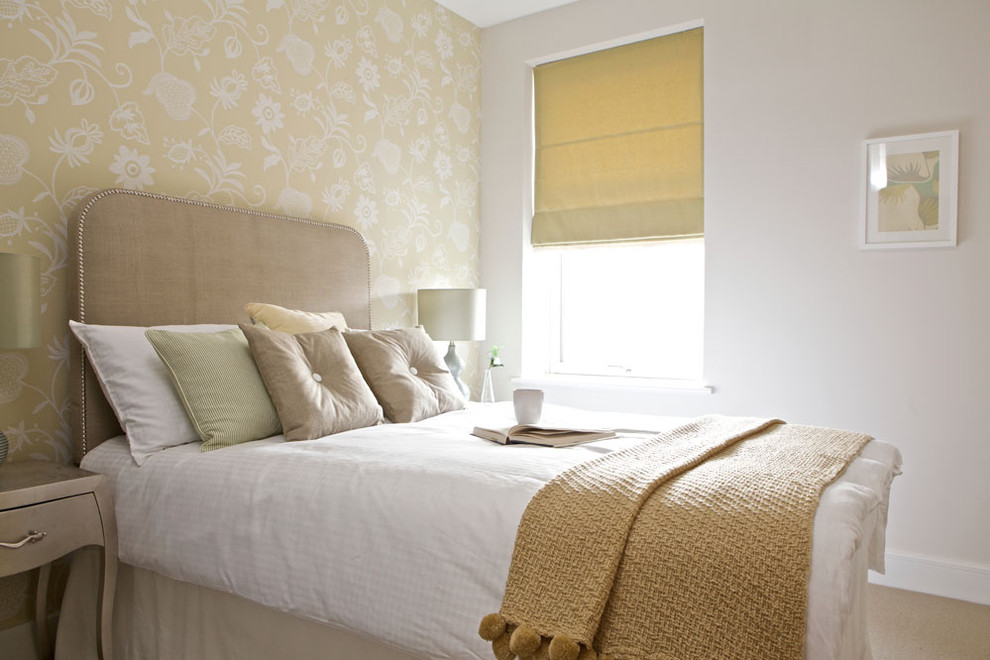 Example of an eclectic guest carpeted bedroom design in Edinburgh with white walls