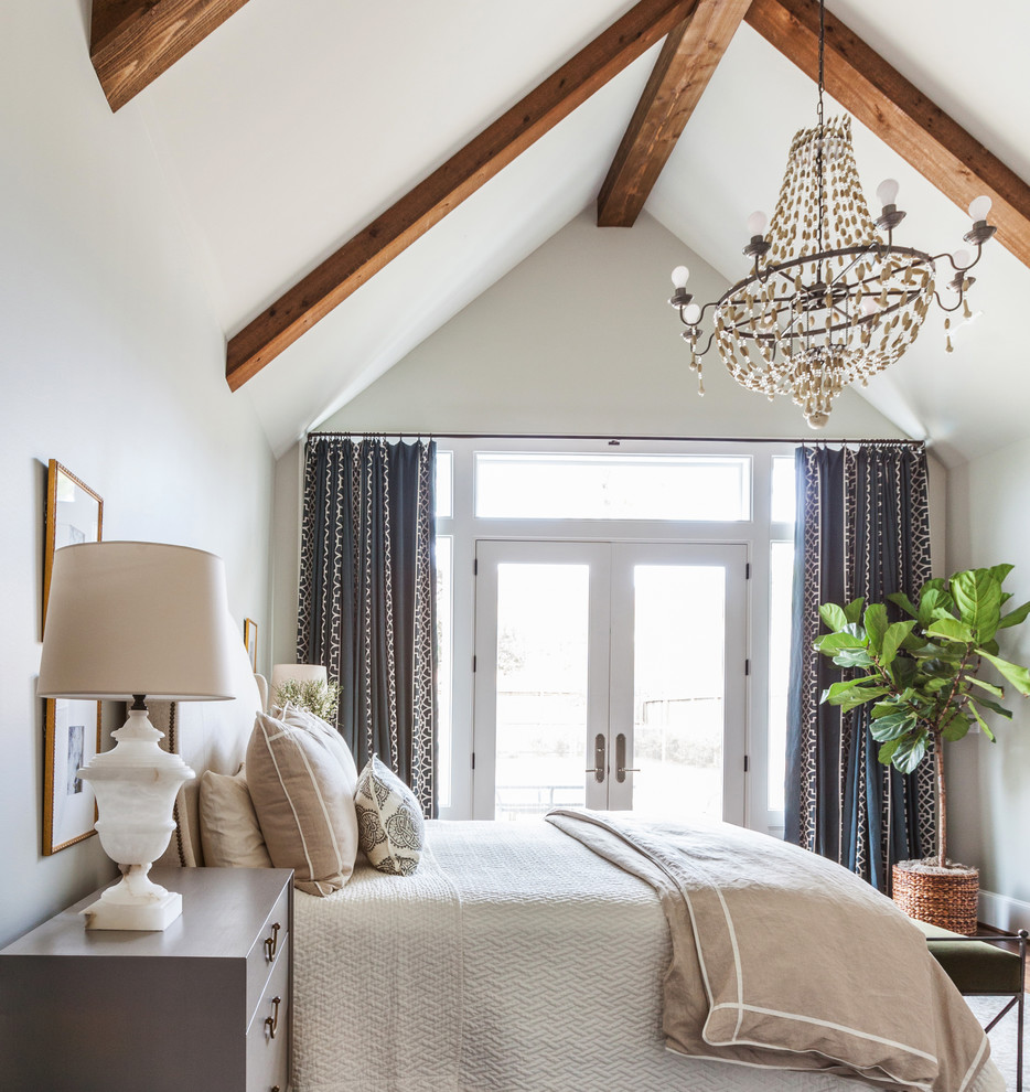 Example of a farmhouse bedroom design in Houston