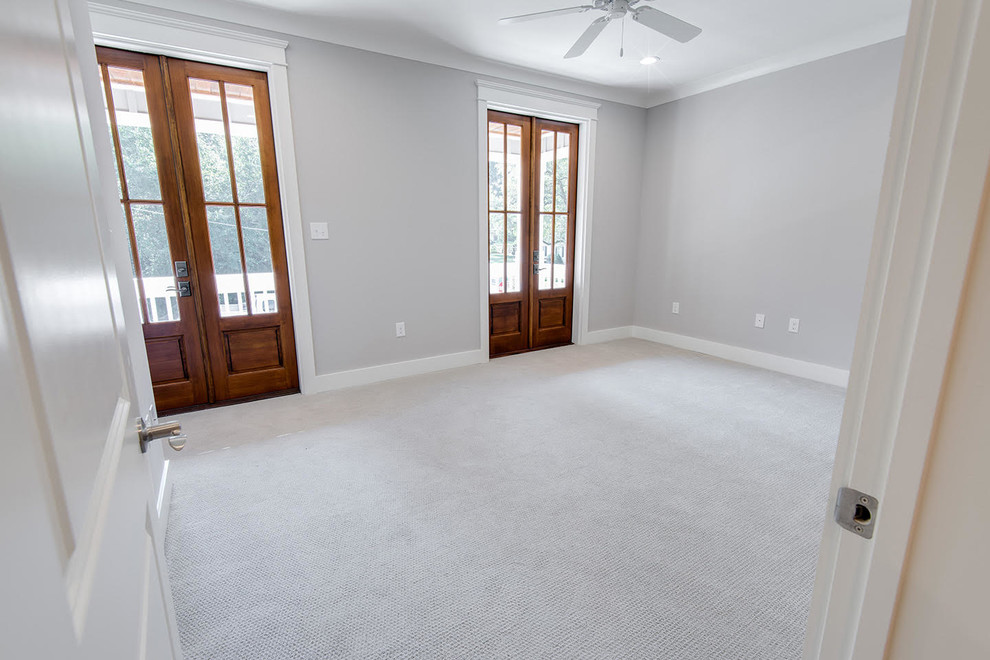 Bedroom - large craftsman guest carpeted bedroom idea in Other with gray walls and no fireplace