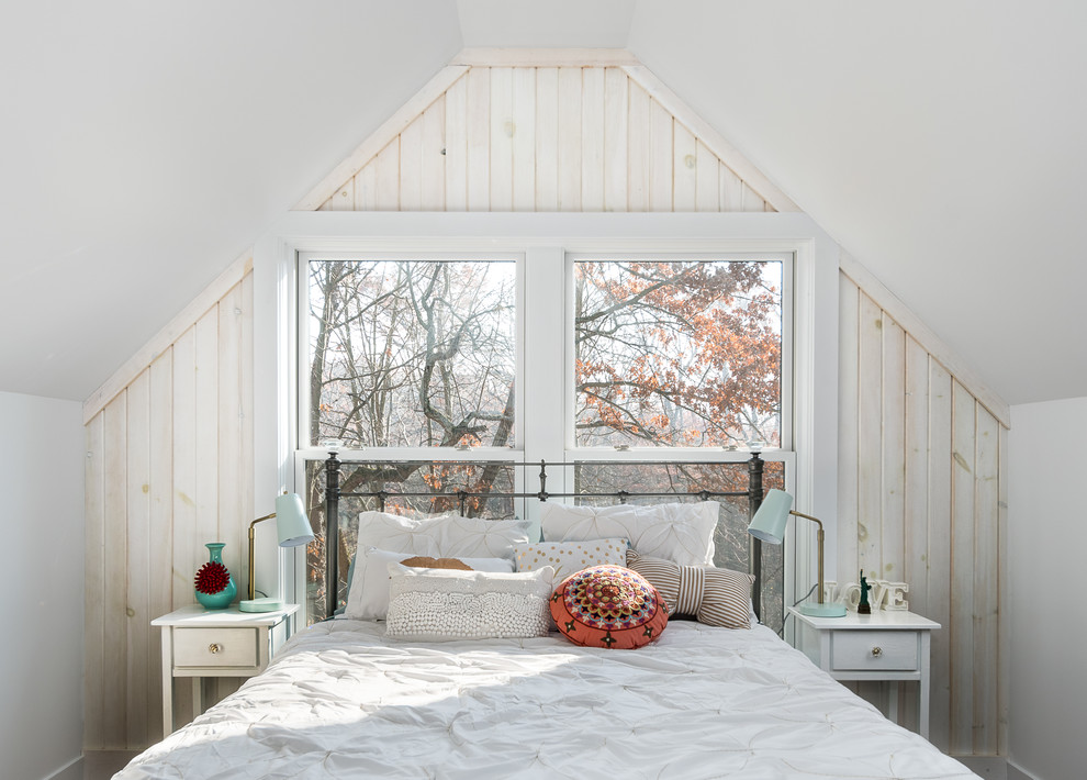 Inspiration for a cottage guest medium tone wood floor bedroom remodel in Grand Rapids with white walls