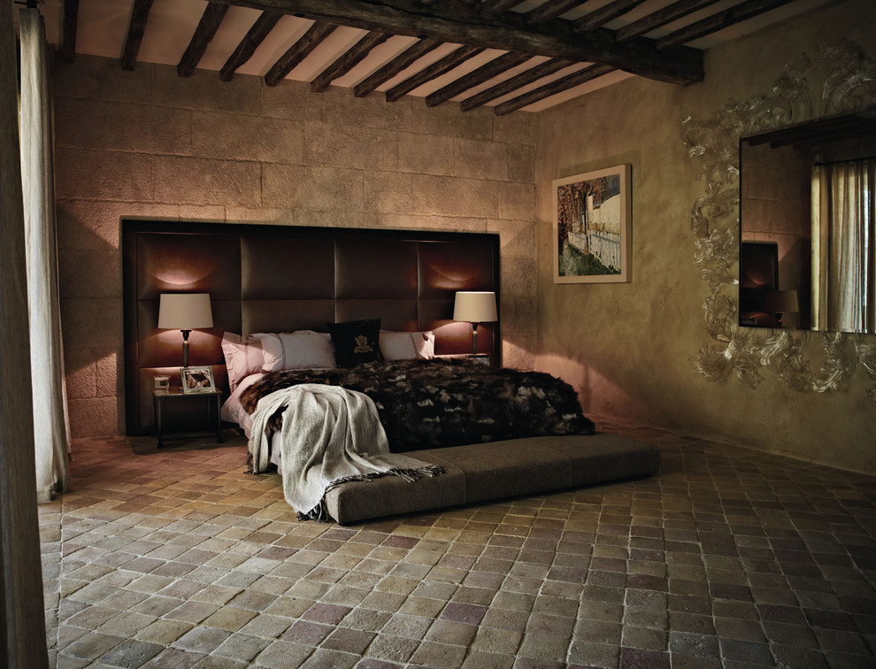 Tuscan terra-cotta tile bedroom photo in Other