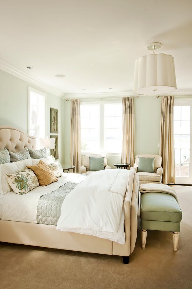Elegant bedroom photo in Portland with green walls