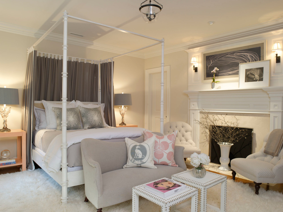 Example of a mid-sized transitional guest carpeted and white floor bedroom design in Dallas with beige walls, a standard fireplace and a stone fireplace