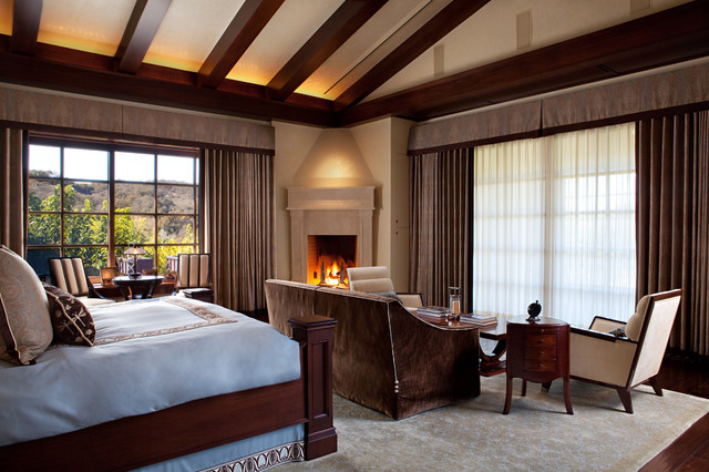elegant bedroom photo in san francisco with a corner fireplace