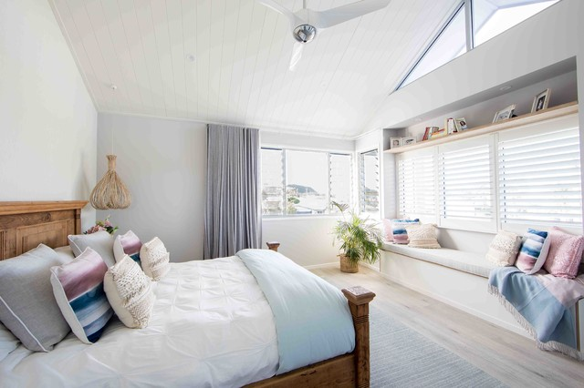 Photo of a beach style bedroom in Gold Coast - Tweed with grey walls.
