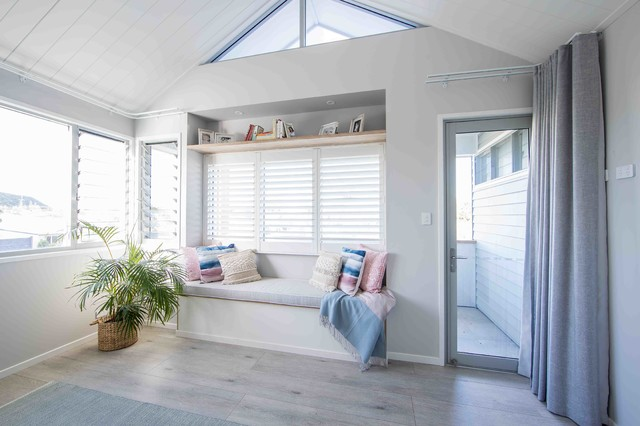 Mid-sized beach style master bedroom in Gold Coast - Tweed with white walls, painted wood floors and grey floor.