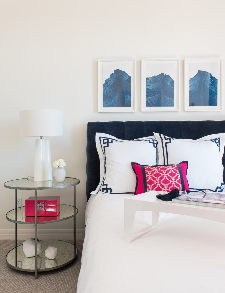 Inspiration for a mid-sized transitional guest carpeted bedroom remodel in Dallas with beige walls