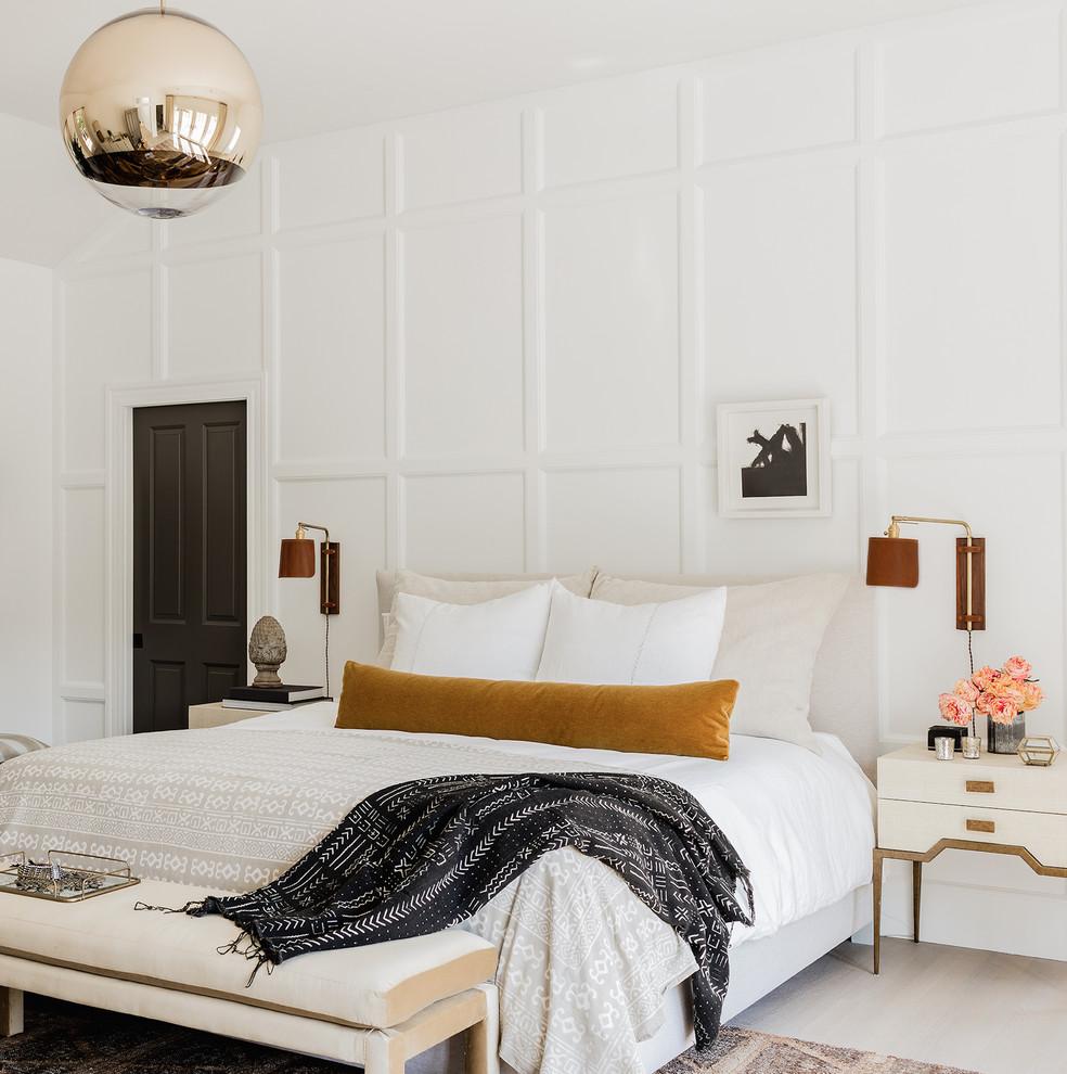 Bedroom - coastal master light wood floor and beige floor bedroom idea with white walls
