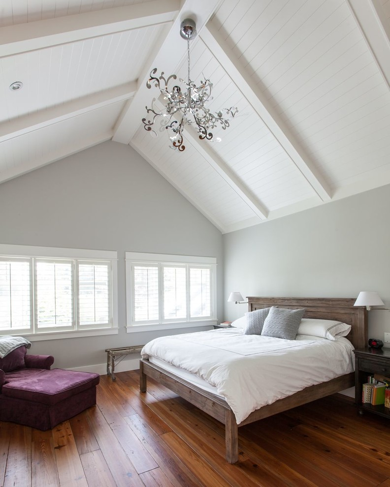 Large elegant master dark wood floor bedroom photo in Vancouver with gray walls