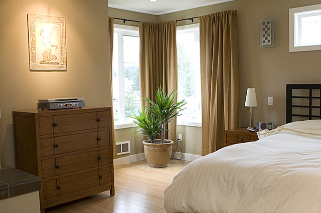 Superior Example Of A Trendy Light Wood Floor Bedroom Design In Seattle With Beige  Walls