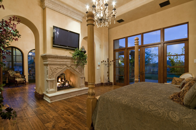 Fireplace in multi million dollar home designed by for Mediterranean master bedroom