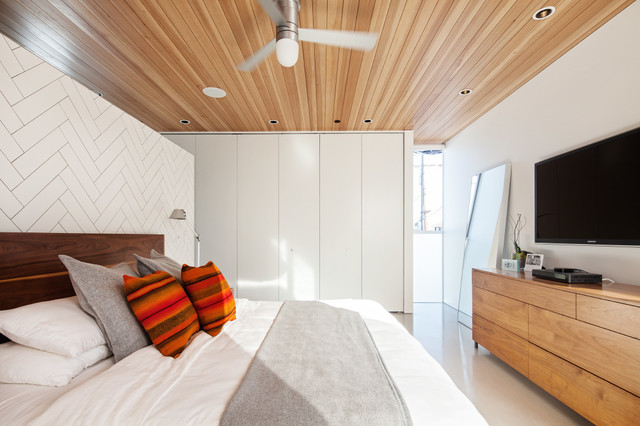 Inspiration for a small contemporary concrete floor bedroom remodel in Los Angeles with white walls