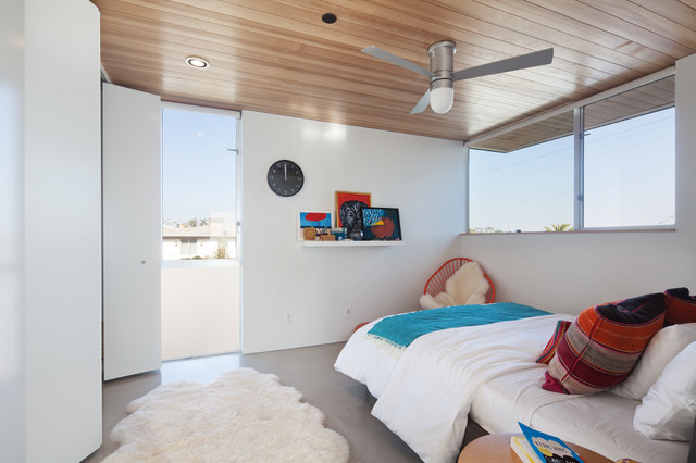 Inspiration for a small modern guest beige floor bedroom remodel in Los Angeles with white walls and no fireplace