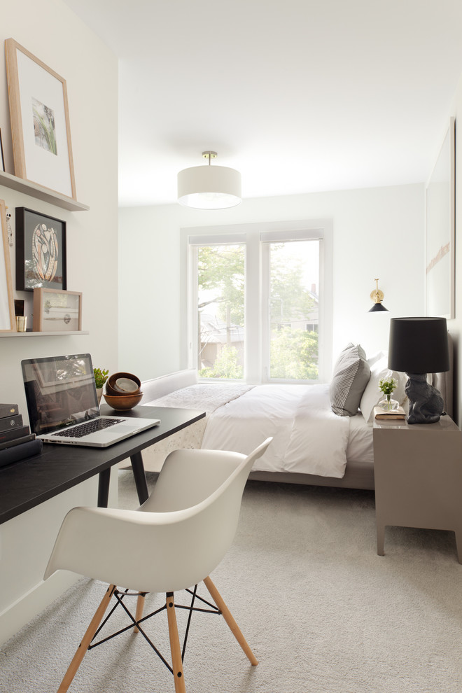Example of a trendy carpeted bedroom design in Vancouver with white walls and no fireplace
