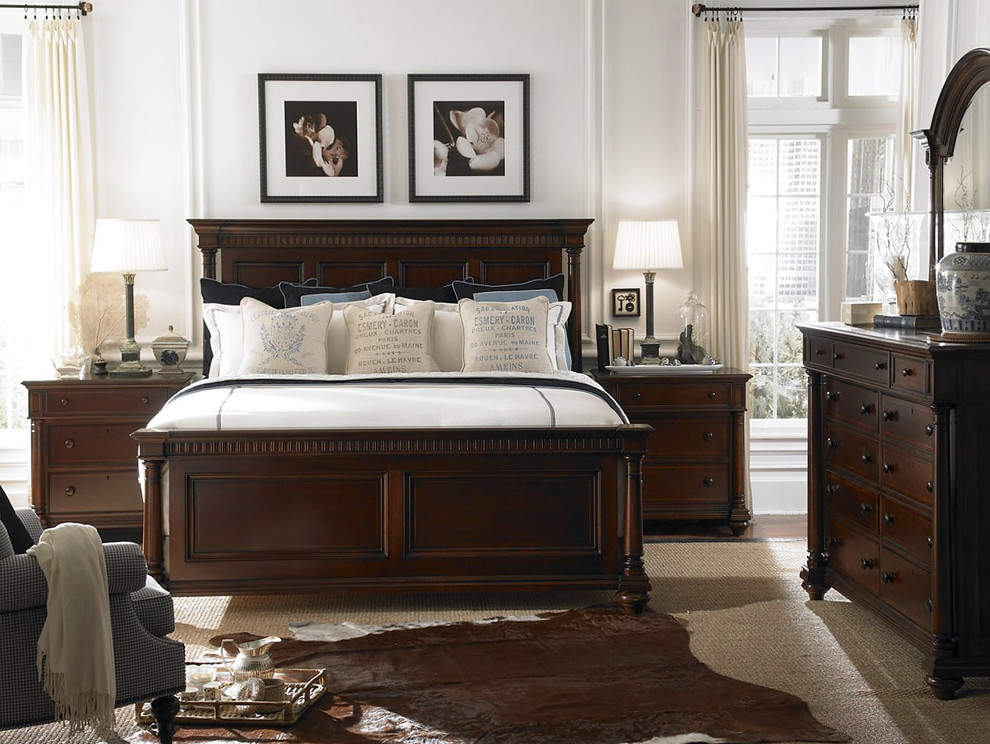 Elegant bedroom photo in Charlotte with white walls