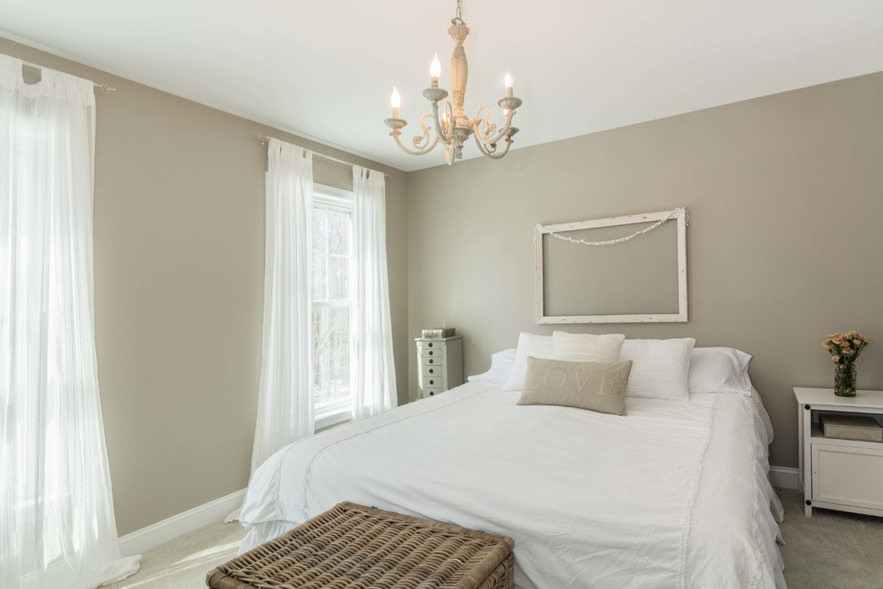 Bedroom - mid-sized farmhouse master carpeted and brown floor bedroom idea in Portland Maine with beige walls and no fireplace