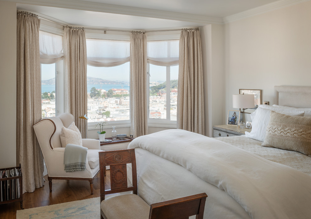 Inspiration for a timeless medium tone wood floor bedroom remodel in San Francisco with beige walls