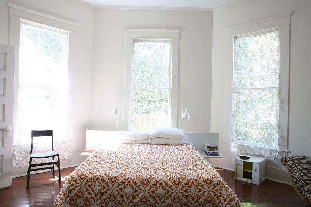 Trendy bedroom photo in New York with white walls