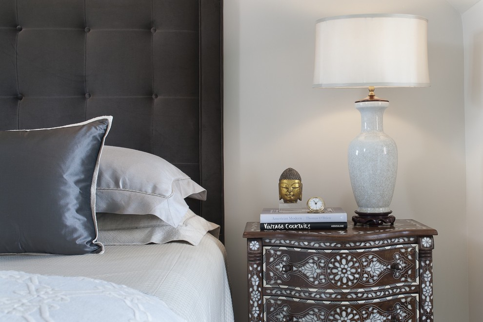 Example of a transitional bedroom design in New York with white walls