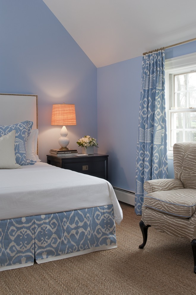 Example of a mid-sized classic guest carpeted and beige floor bedroom design in New York with blue walls and no fireplace