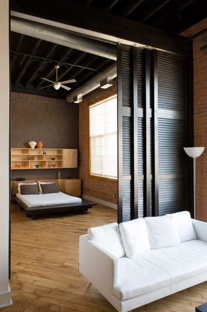 Example of a mountain style light wood floor bedroom design in Detroit with brown walls