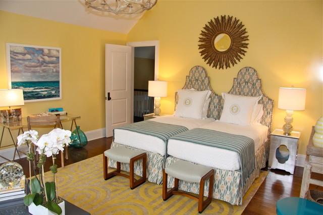 twin bedroom. Eclectic dark wood floor bedroom photo in New York with yellow walls Twin Bed  Houzz