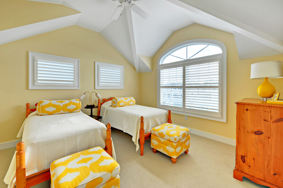 Example of a beach style guest carpeted bedroom design in Philadelphia with yellow walls