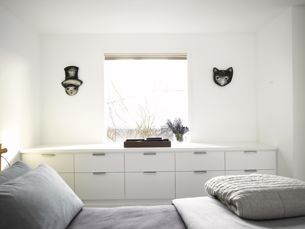 Inspiration for a contemporary bedroom remodel in Seattle with white walls