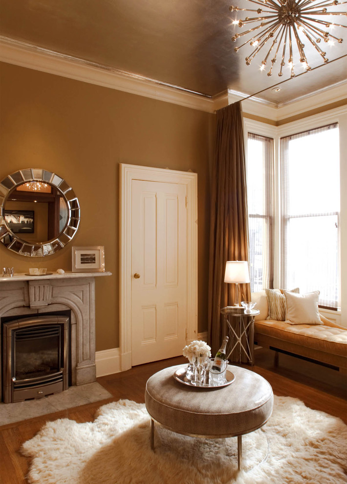 Ornate bedroom photo in San Francisco with brown walls and a standard fireplace