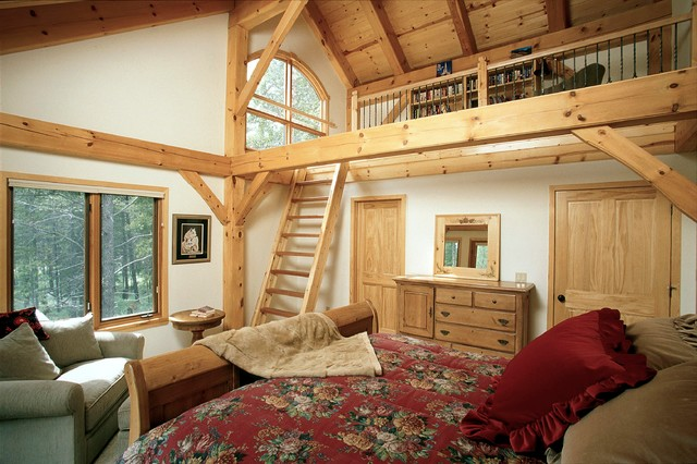 guest bedroom with loft in timber frame ski home rustic