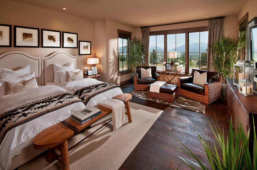 Inspiration for a southwestern dark wood floor bedroom remodel in Phoenix with beige walls
