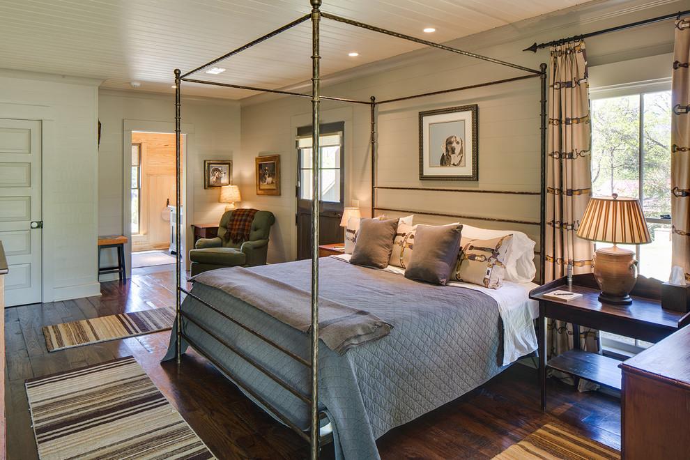 Bedroom - large country master dark wood floor and brown floor bedroom idea in Nashville with beige walls