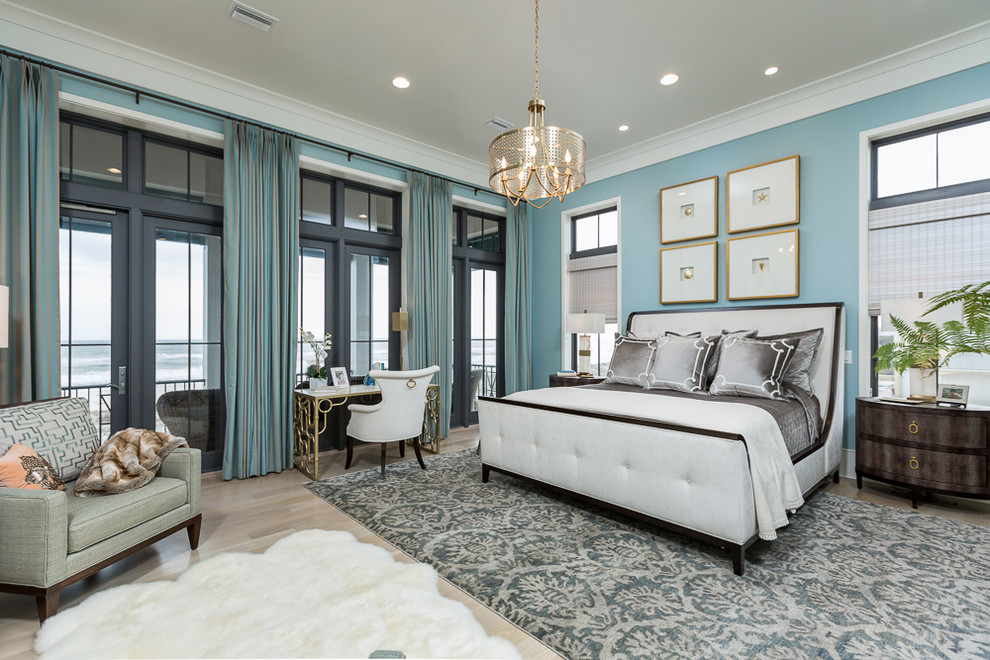 Inspiration for a large transitional master light wood floor bedroom remodel in Miami with blue walls and no fireplace