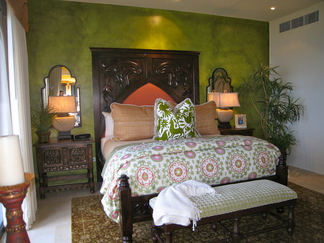 Example of a large tuscan master travertine floor bedroom design in Mexico City with green walls and no fireplace