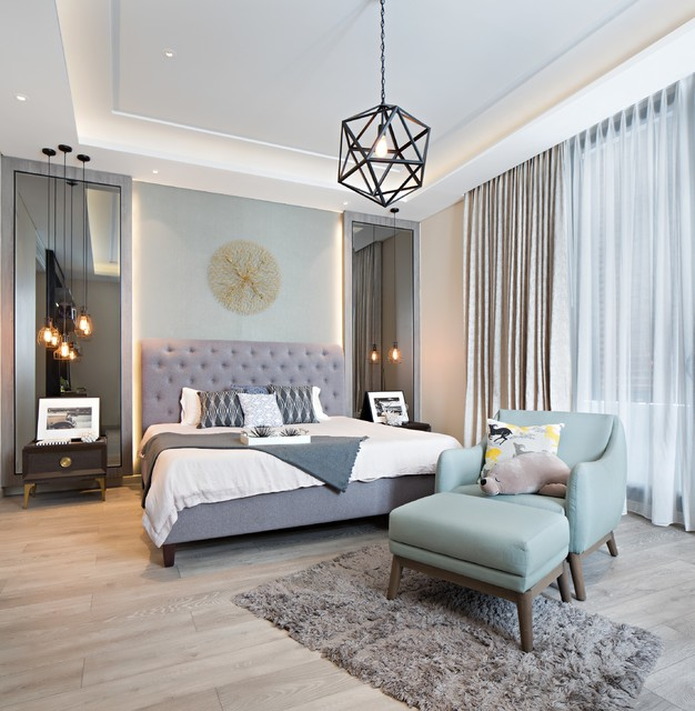 Example of a transitional master light wood floor bedroom design in Other with beige walls