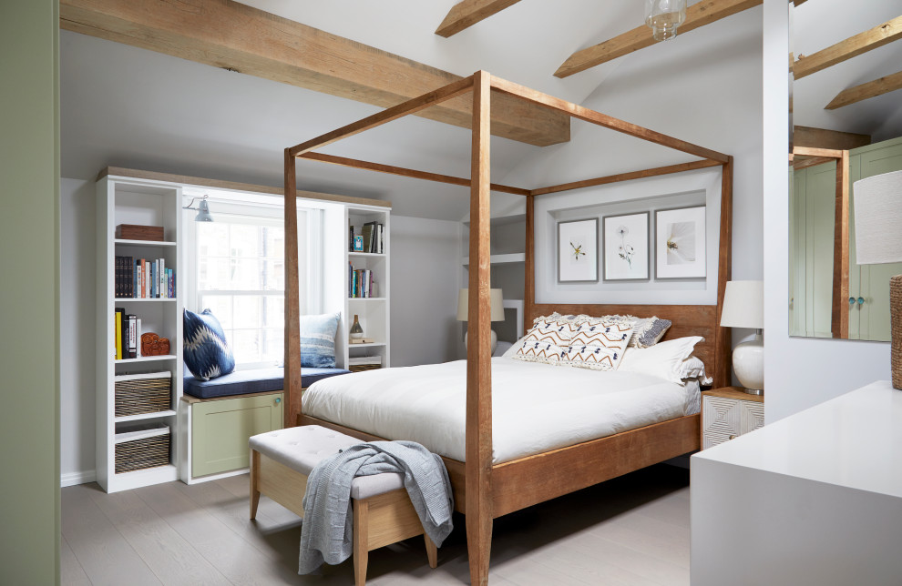 This is an example of a small traditional master bedroom in London with grey walls, light hardwood flooring and grey floors.