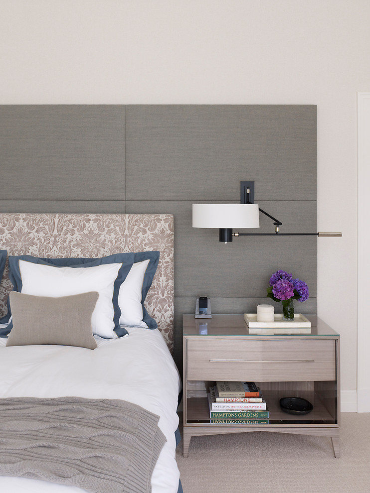 Beach style carpeted bedroom photo in New York with beige walls