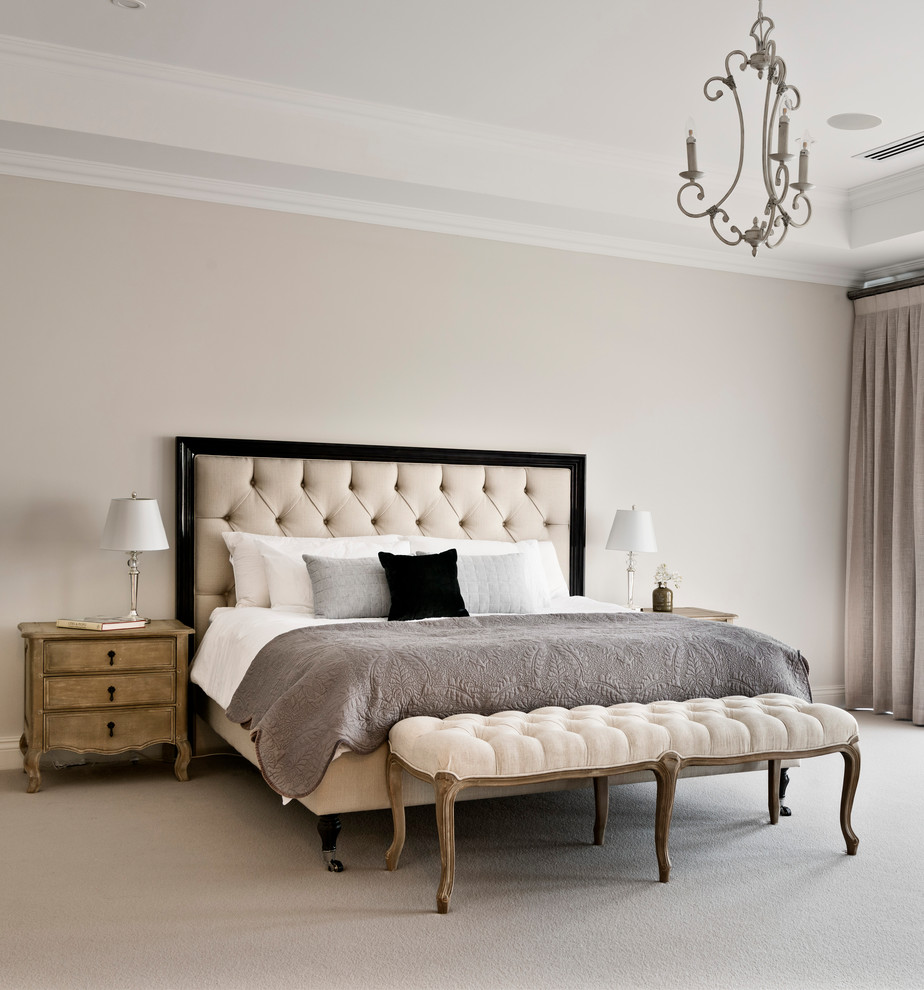 Example of a classic master carpeted and beige floor bedroom design in Perth with beige walls