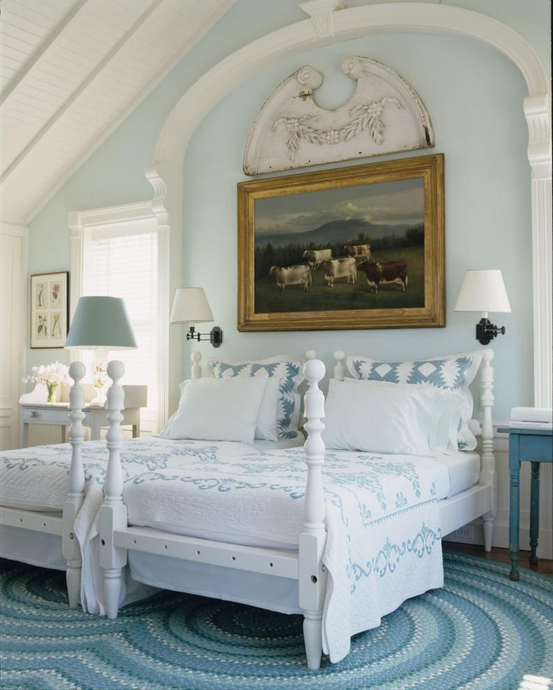 Beach style dark wood floor bedroom photo in New York with blue walls