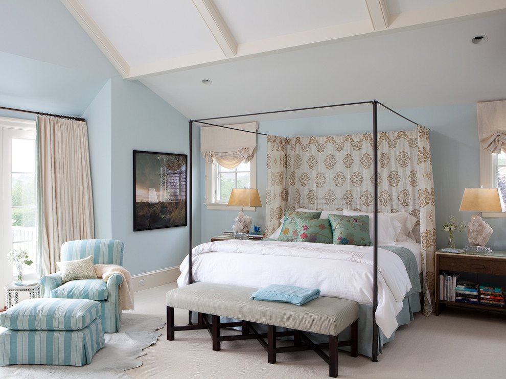 Example of a huge transitional master carpeted bedroom design in New York with blue walls