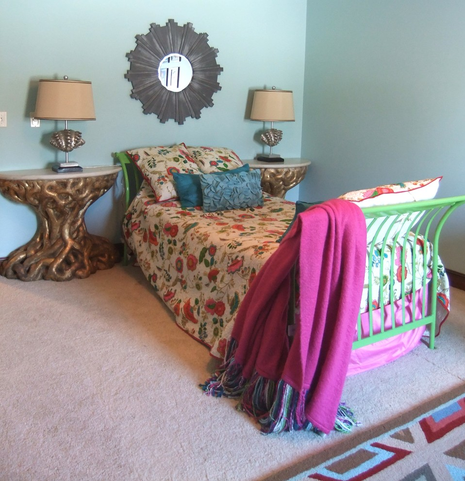 Example of an eclectic carpeted bedroom design in Minneapolis with blue walls
