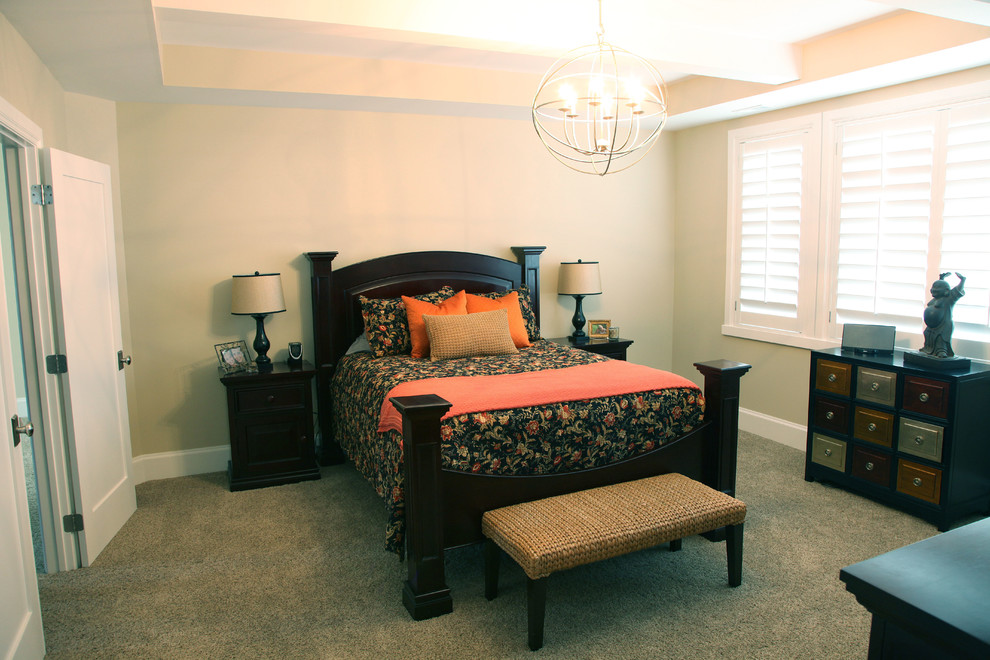 Inspiration for a mid-sized timeless master carpeted bedroom remodel in Salt Lake City with beige walls and no fireplace
