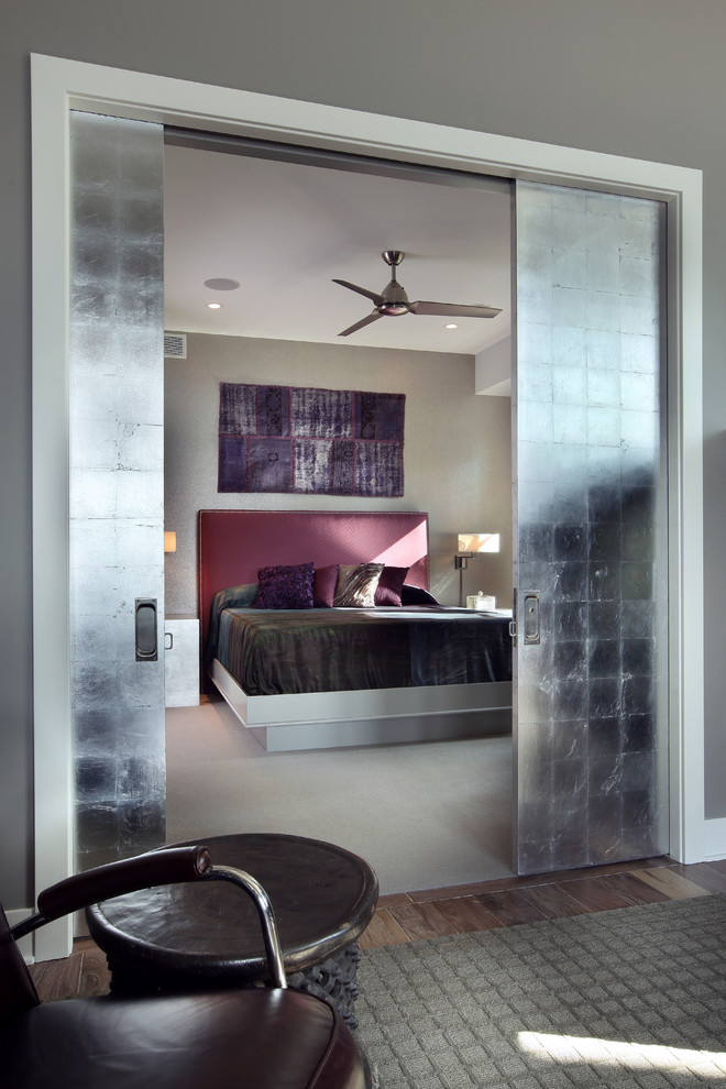 Inspiration for a large contemporary guest carpeted bedroom remodel in Grand Rapids with gray walls
