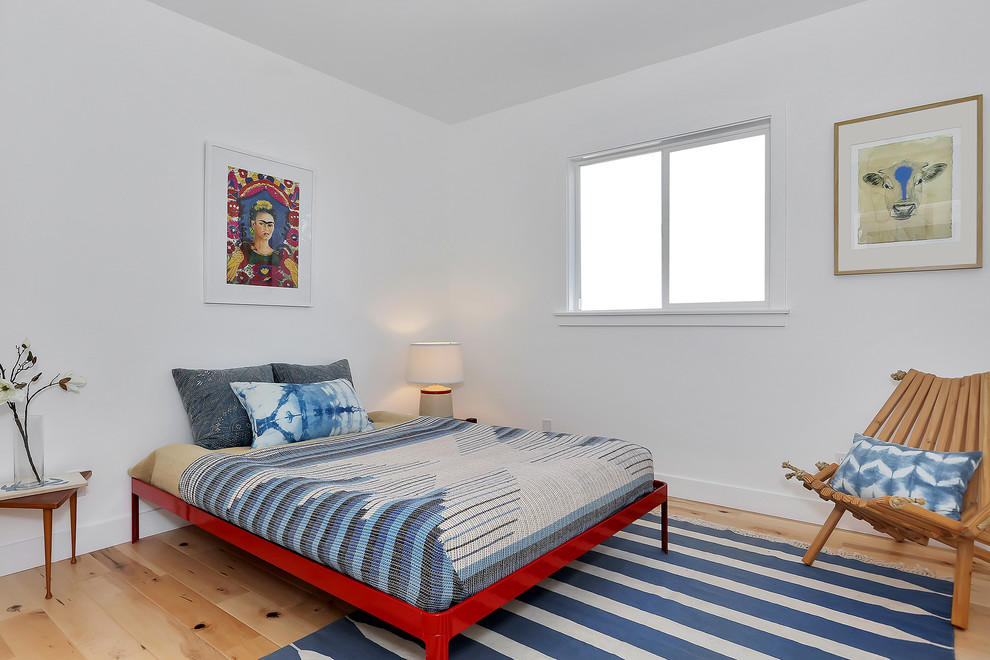 Inspiration for an eclectic bedroom remodel in Los Angeles with white walls