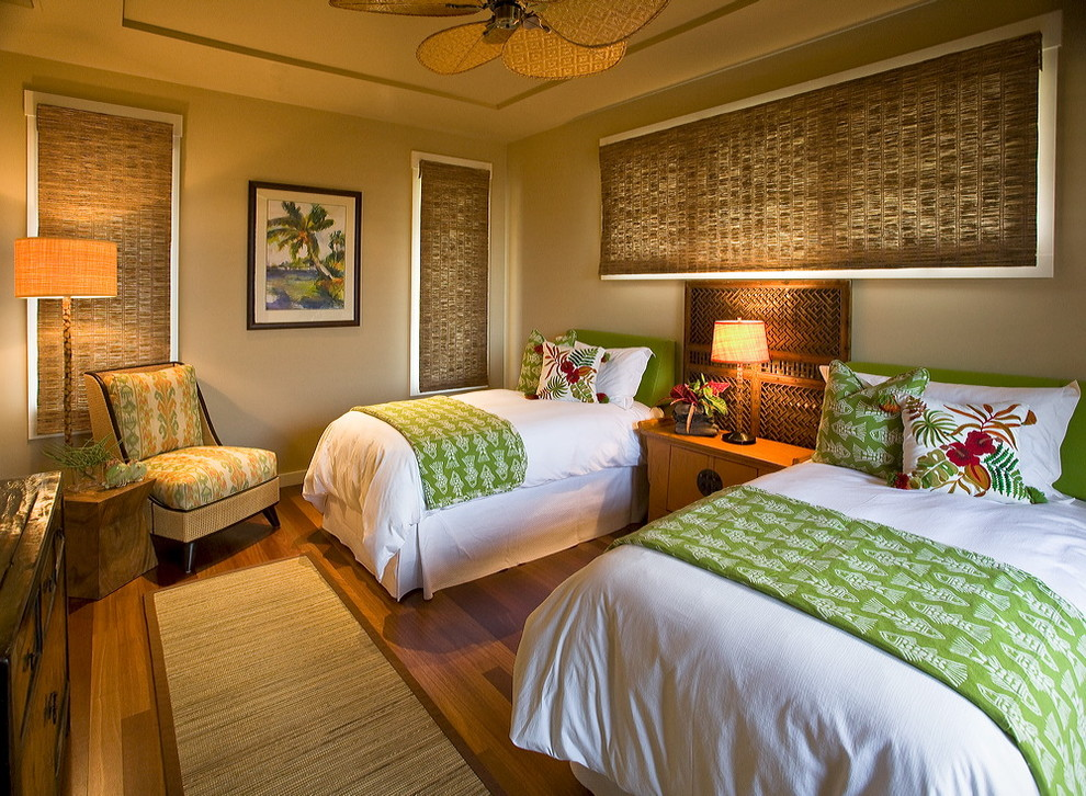 Example of an island style guest dark wood floor bedroom design in Hawaii with gray walls
